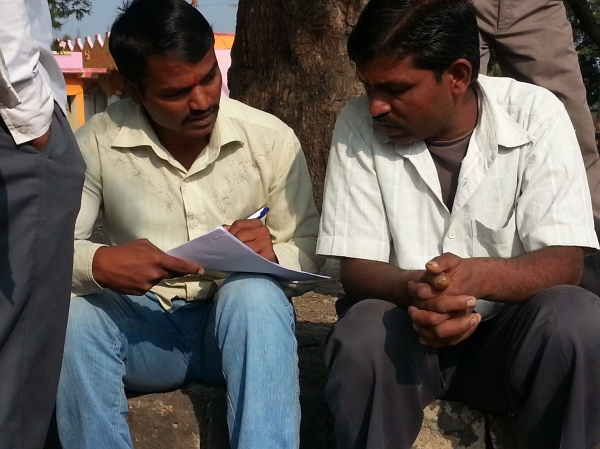 A farmer completing a survey during stage 1 research
